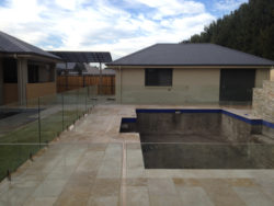 Glass pool fencing and spray on finish concrete